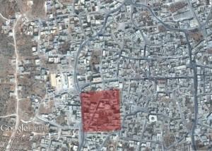 Una delle zone residenziali colkpite dai raid russi. Foto tratta dal report di Amnesty International