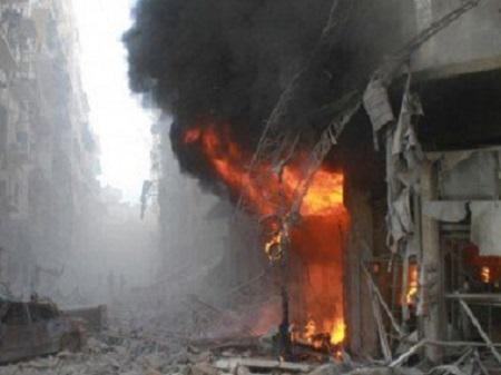 Siria edifici in fiamme sotto gli attacchi russi_G