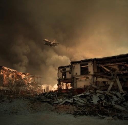 Siria Jet militare vola sopra rovine2