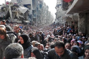 Refugees crowd in Sirian city