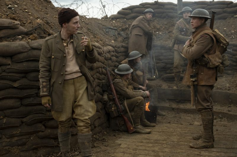 """Lieutenant Leslie (Andrew Scott, left), Schofield (George MacKay, right), Blake (Dean-Charles Chapman, second from the right) with fellow soldiers in """"1917,"""" the new epic from Oscar®-winning filmmaker Sam Mendes."""